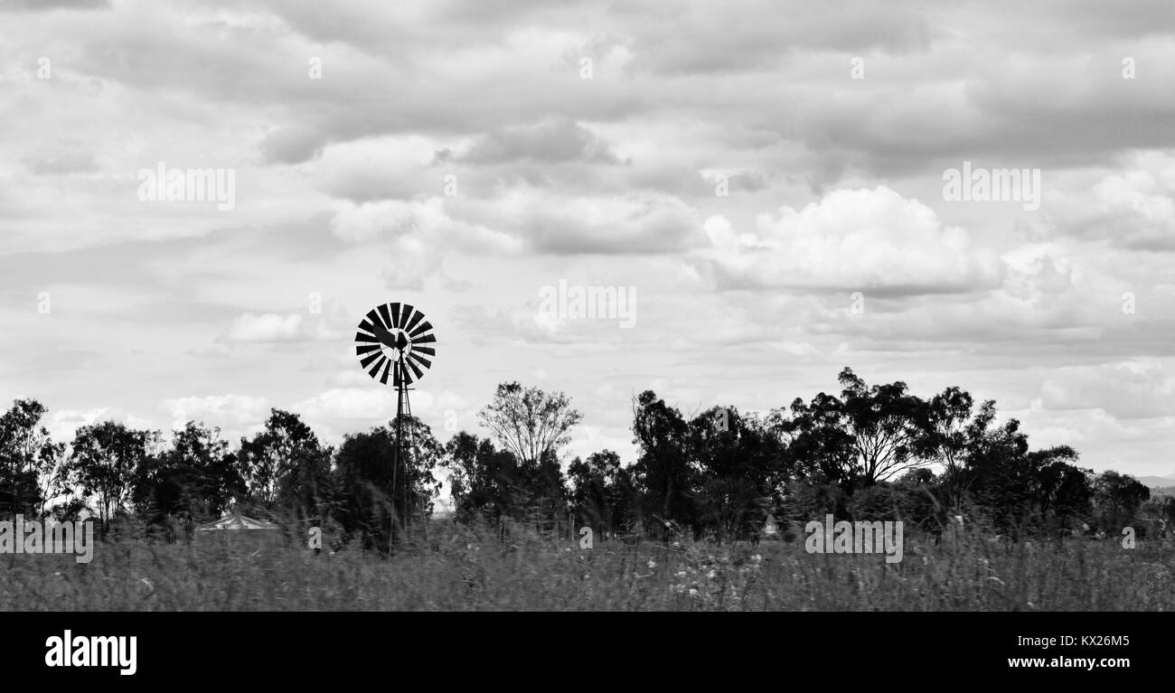 Windmill for pumping ground water, Dramatic black and white images of Australia, december, Queensland, Australia - Stock Image