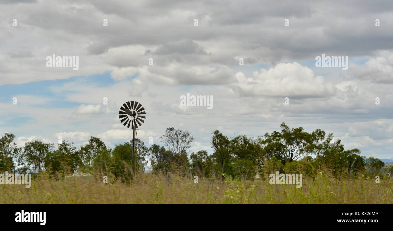 Windmill for pumping ground water, Rural scenes from country australian landscapes, Queensland, Australia - Stock Image