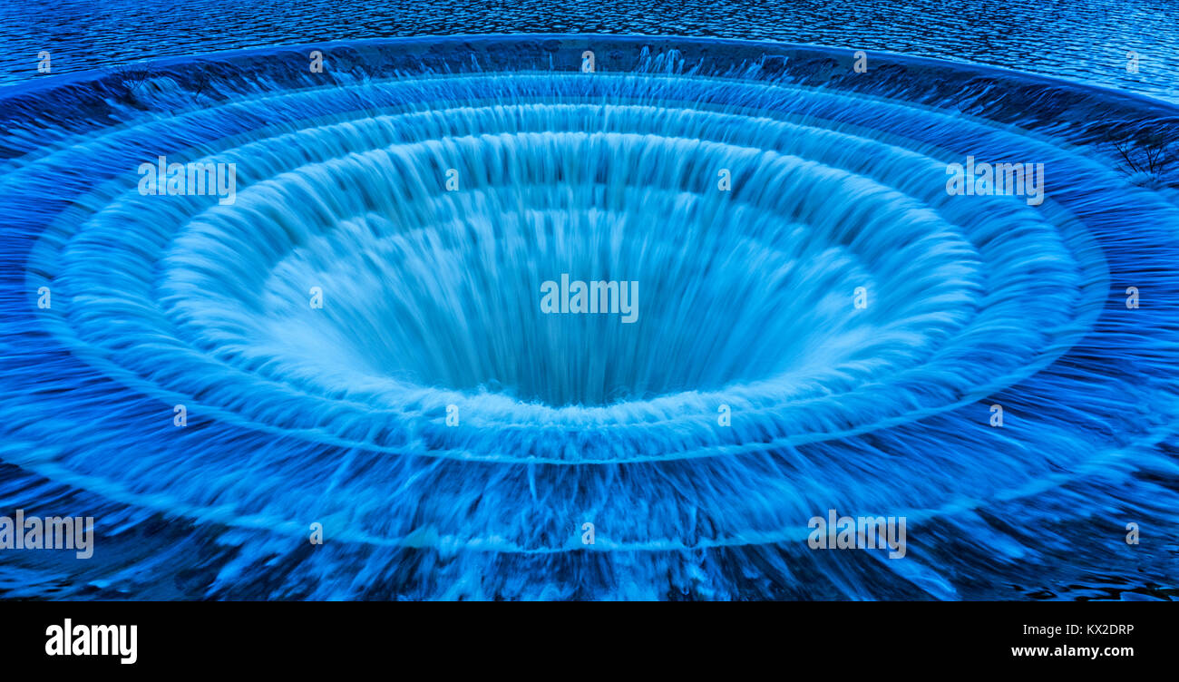 Blue plughole, also known as bellmouth at Ladybower Reservoir, Derbyshire, UK - Stock Image