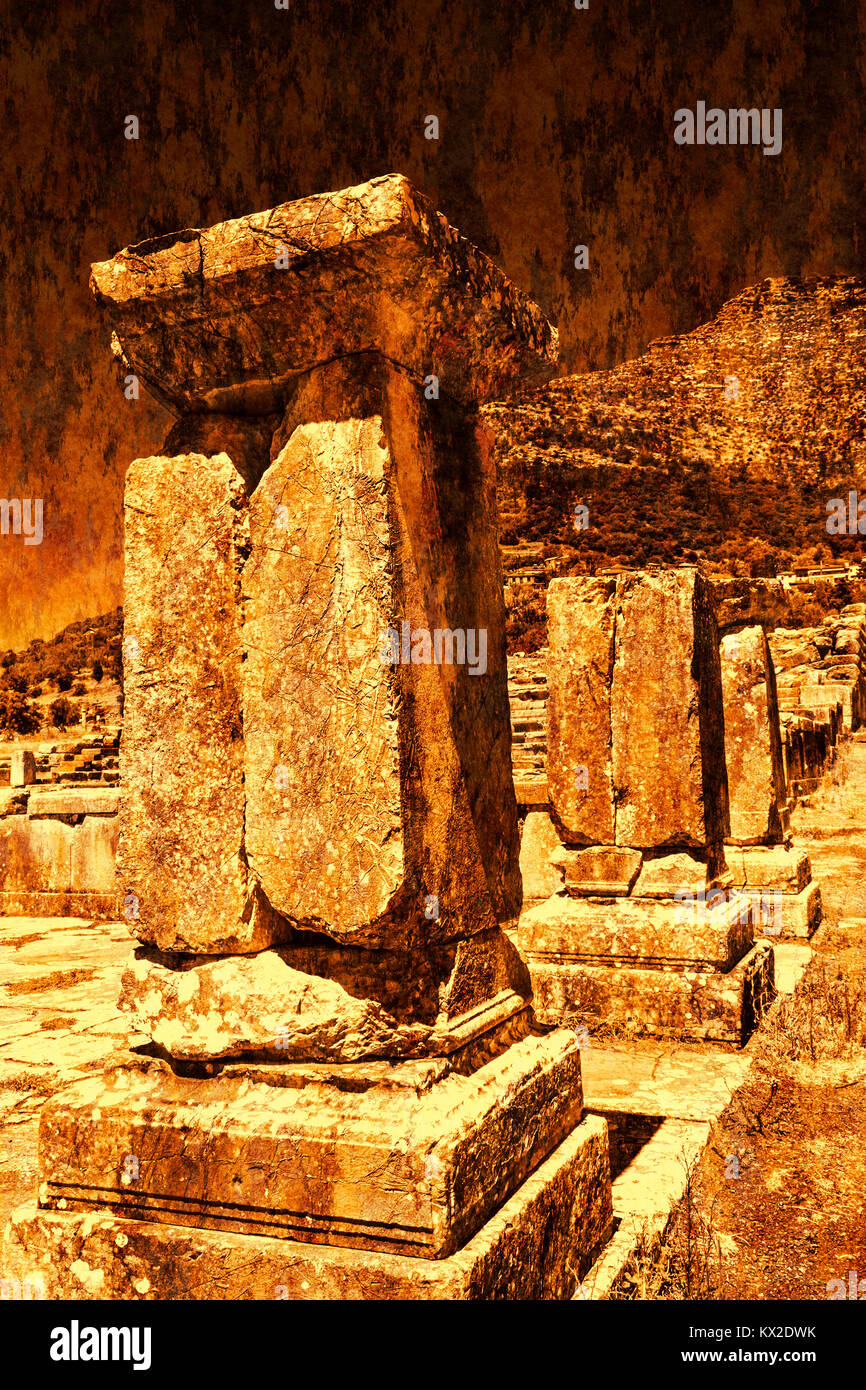 Pillar ruins at Ancient Messini, Messinia at Peloponnese, Greece - Rust effect - Stock Image