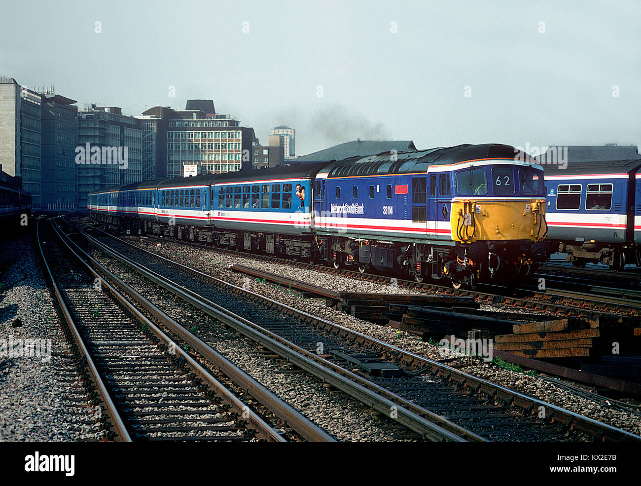 """In May 1992 33114 was repainted into Network SouthEast colours and named """"Ashford 150"""". The celebrity Crompton is seen working a """"Network Express"""" service at Vauxhall. 29th July 1992. Stock Photo"""