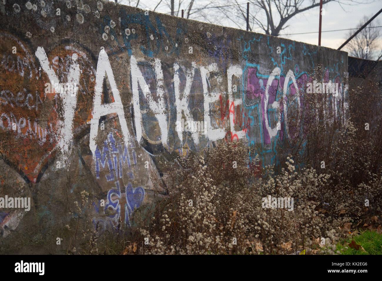 Anti-America inscription Yankee go home mural graffiti on a wall in Zemun, Belgrade, Serbia - Stock Image