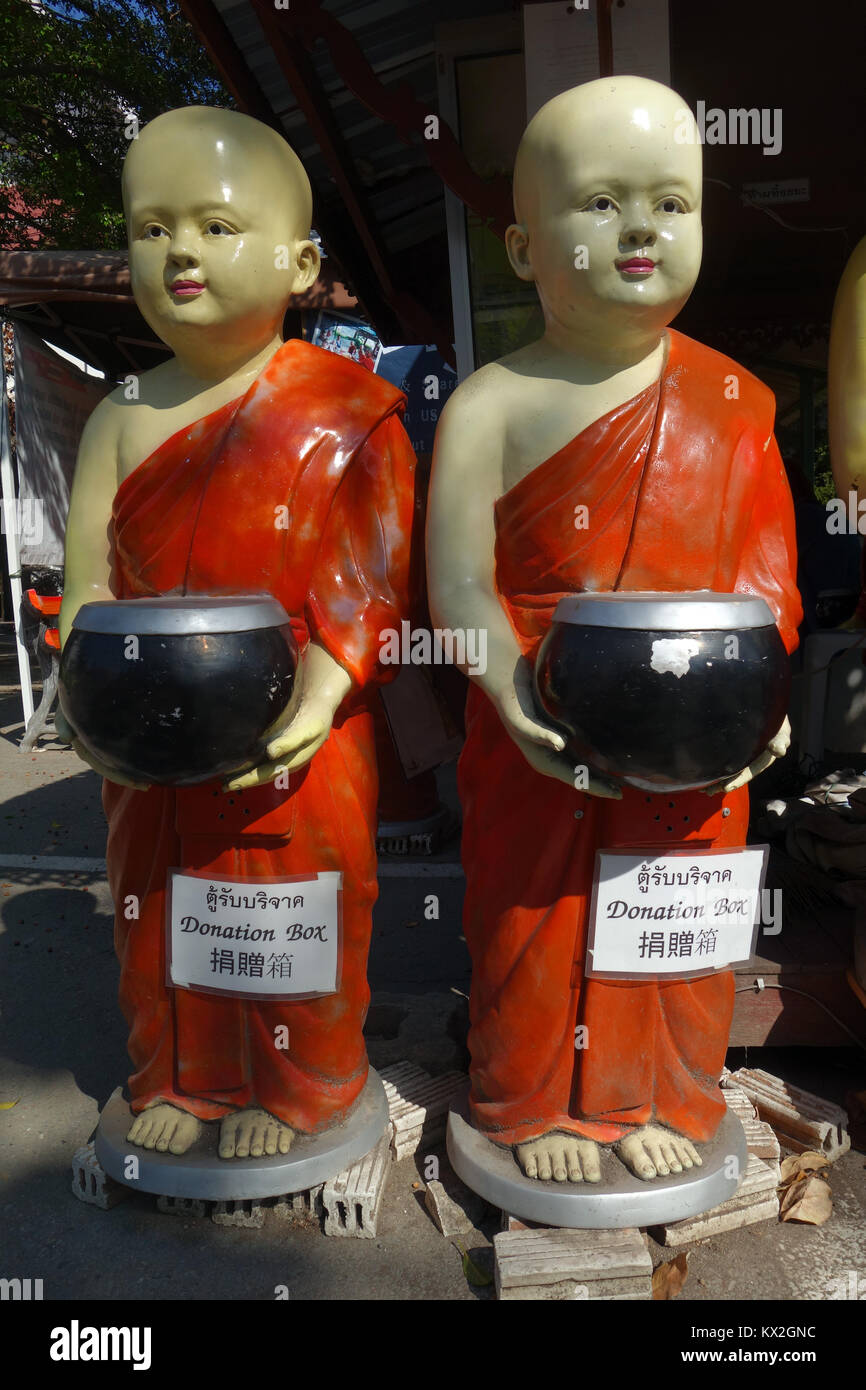 Donation boxes in the shape of young monks, Wat Chedi Luang, Chiang Mai, Thailand. No PR - Stock Image