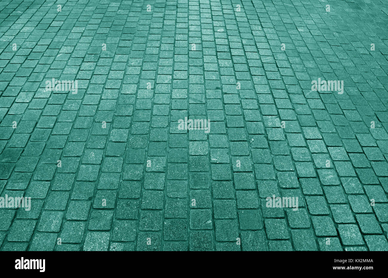 Block paved pathway in sea green color, for background, pattern - Stock Image