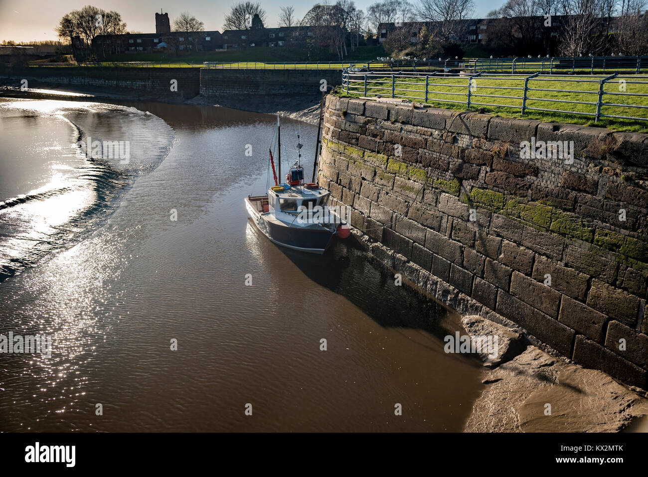 Boat berthed at the dock wall of Spike Island on  the river Mesrey at Widnes. - Stock Image