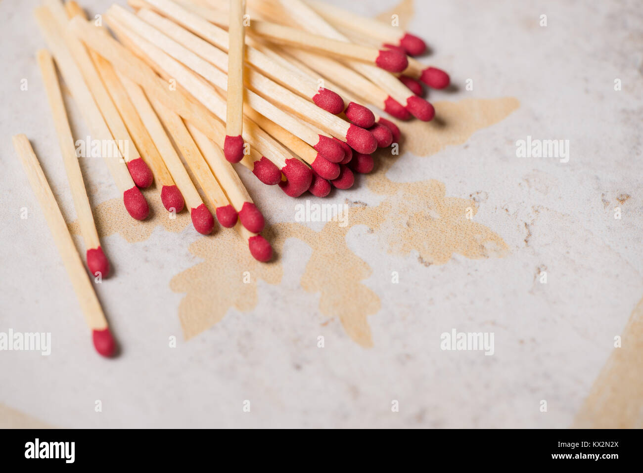 Matches on tile or ceramic background with copy space. - Stock Image