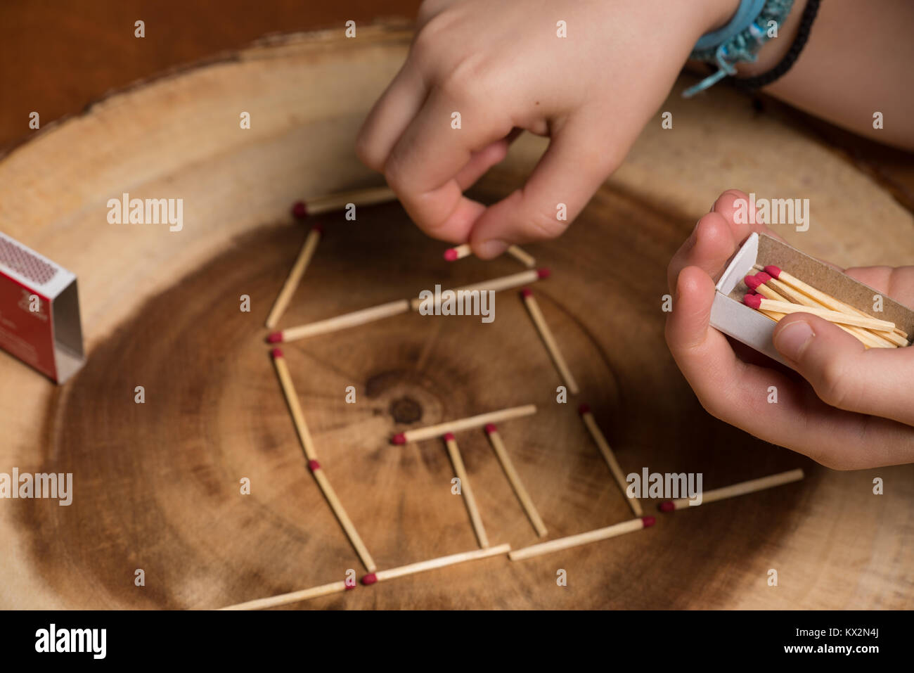 Child playing with matches. - Stock Image