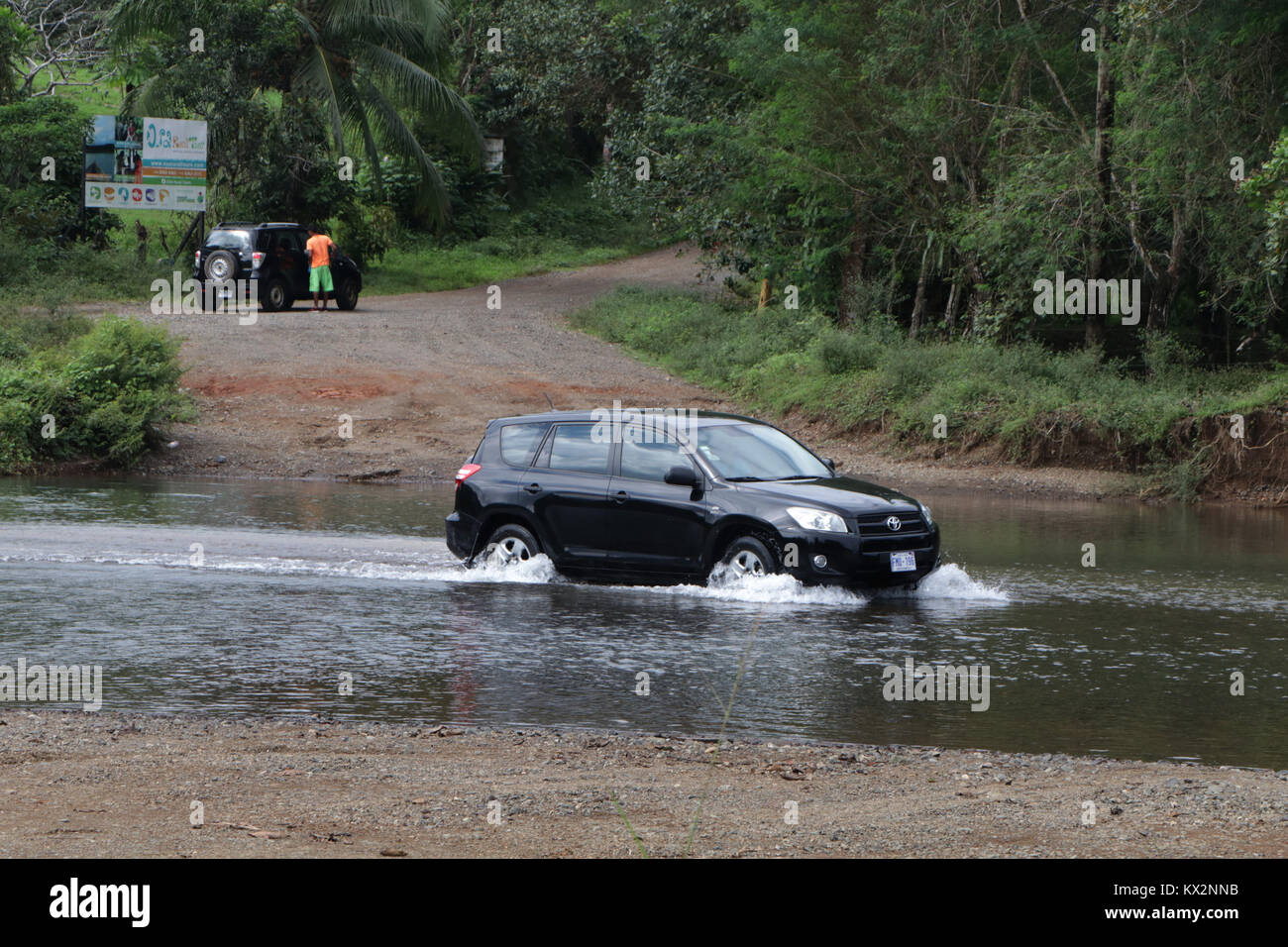 Car crossing river near Drake Bay Costa Rica Osa Peninsula Stock Photo