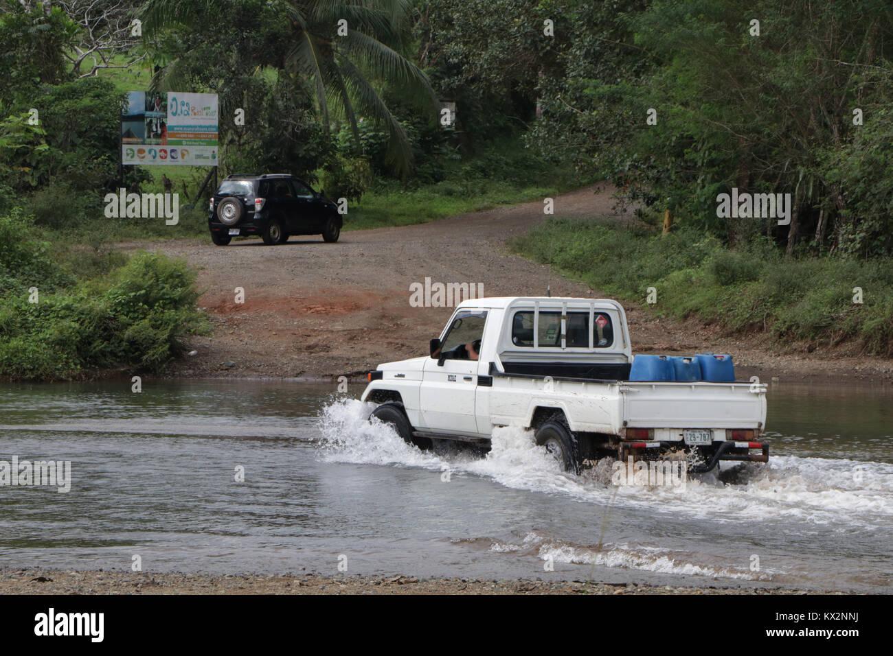 Car crossing river near Drake Bay Costa Rica Osa Peninsula Stock Photo