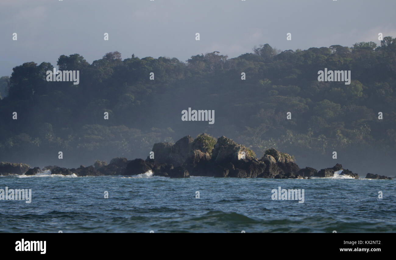 Boat with tourist view from ocean Corcovado national Park Osa Peninsula Costa Rica Stock Photo