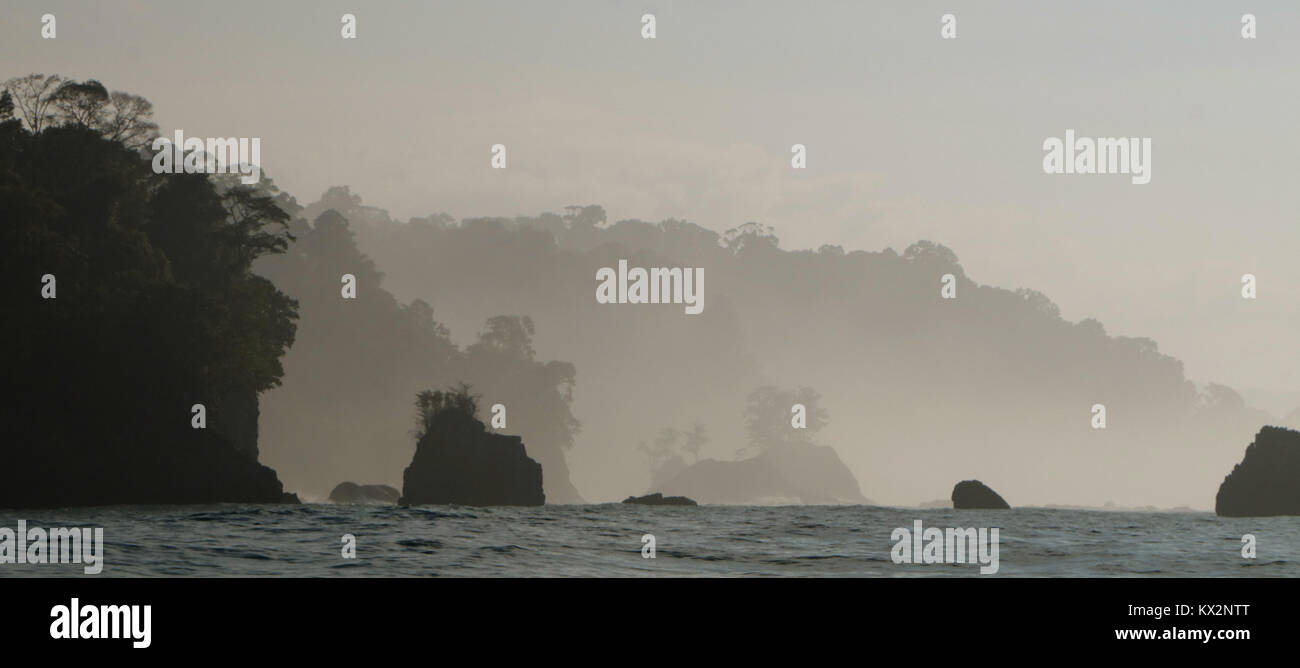 Boat with tourist view from ocean Corcovado national Park Osa Peninsula Costa Rica - Stock Image