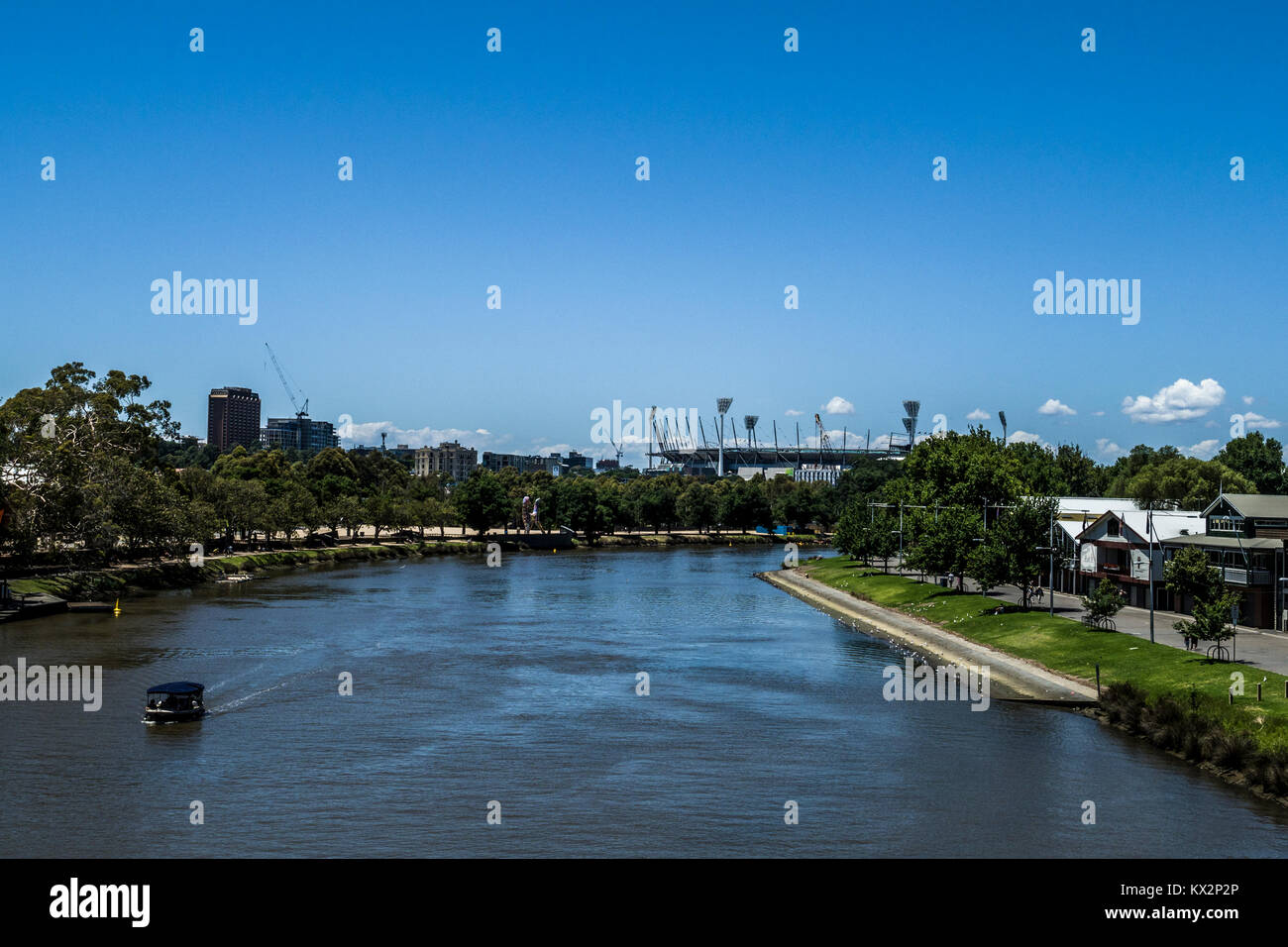 The Yarra river with the Melbourne Cricket Ground (MCG) in the distance, Melbourne, Victoria, Australia. - Stock Image