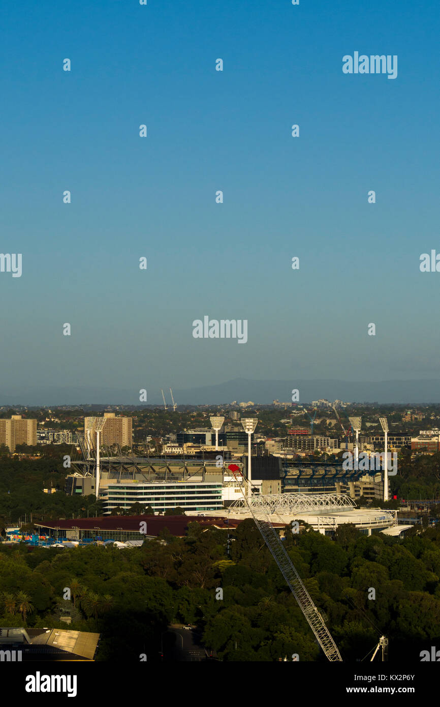View across East Melbourne with sporting arenas in Yarra Park (Melbourne Cricket Ground - central) and Melbourne - Stock Image
