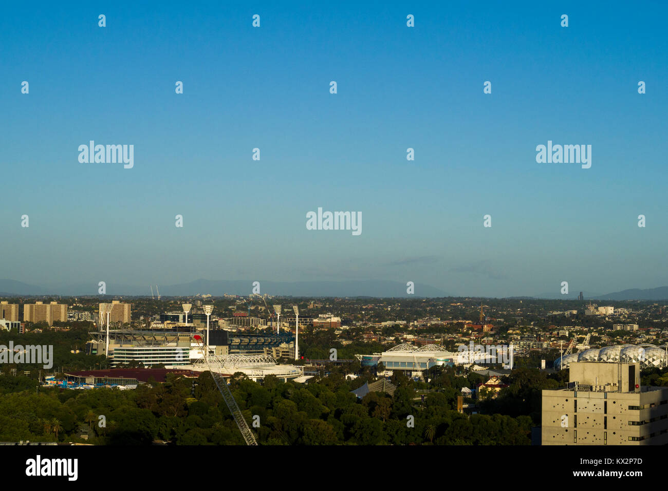 View across East and South-East Melbourne with sporting venues in and around Melbourne Park in the foreground, Melbourne, - Stock Image