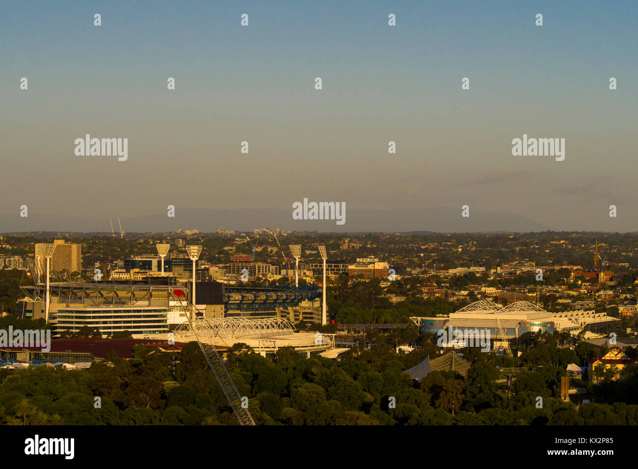 Sunsetting on the Melbourne Cricket Ground and the major tennis courts for the Australian Open in Melbourne Park, - Stock Image