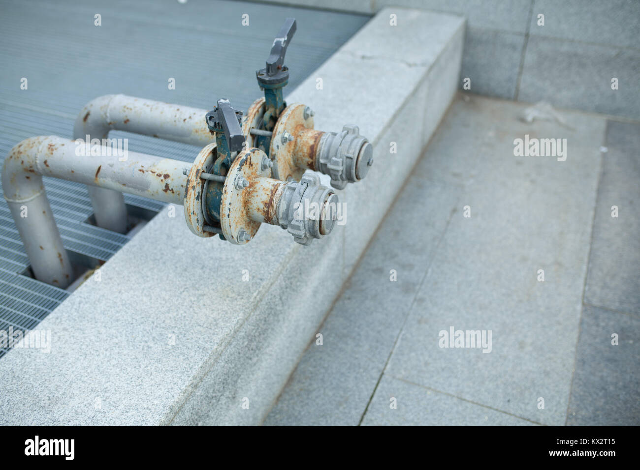 two Outdoor main water shut off valve system compose of brass plumbing gate valve - Stock Image