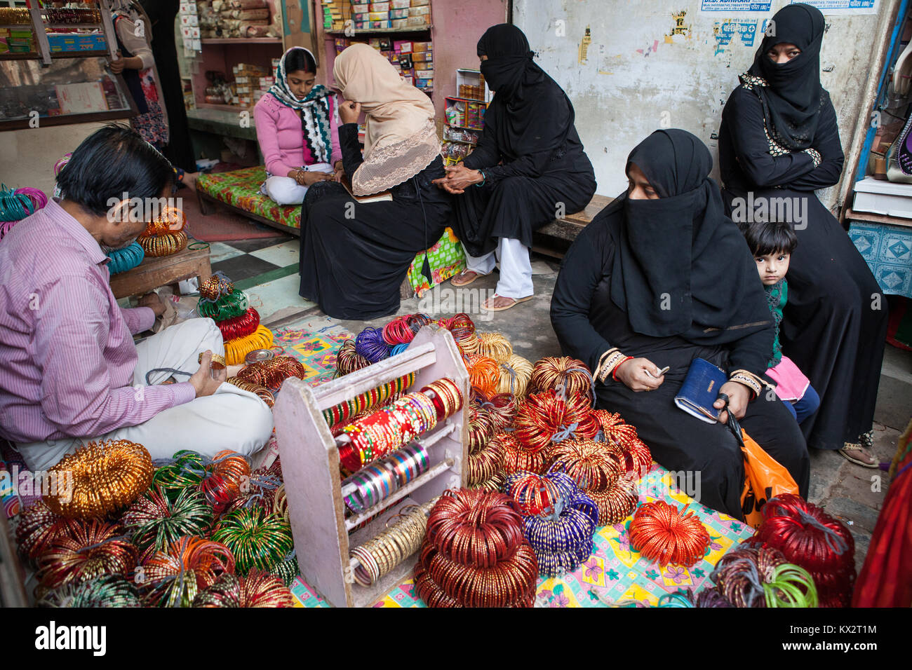 Muslim women buying bangles in the bazaar at Faizabad - Stock Image