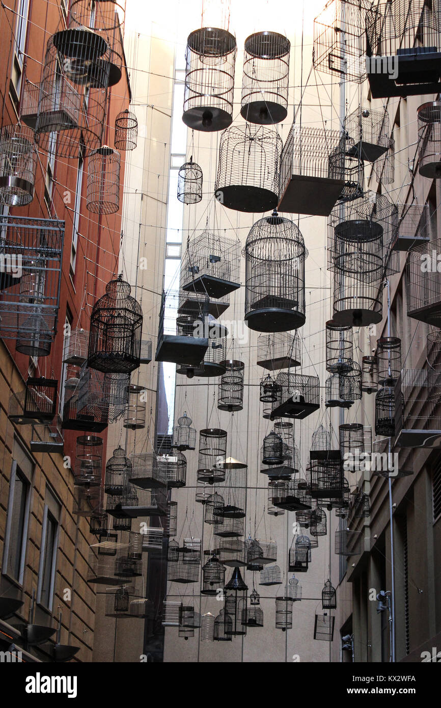 artistic installation 'Forgotten Songs', hanging empty bird cages - Stock Image