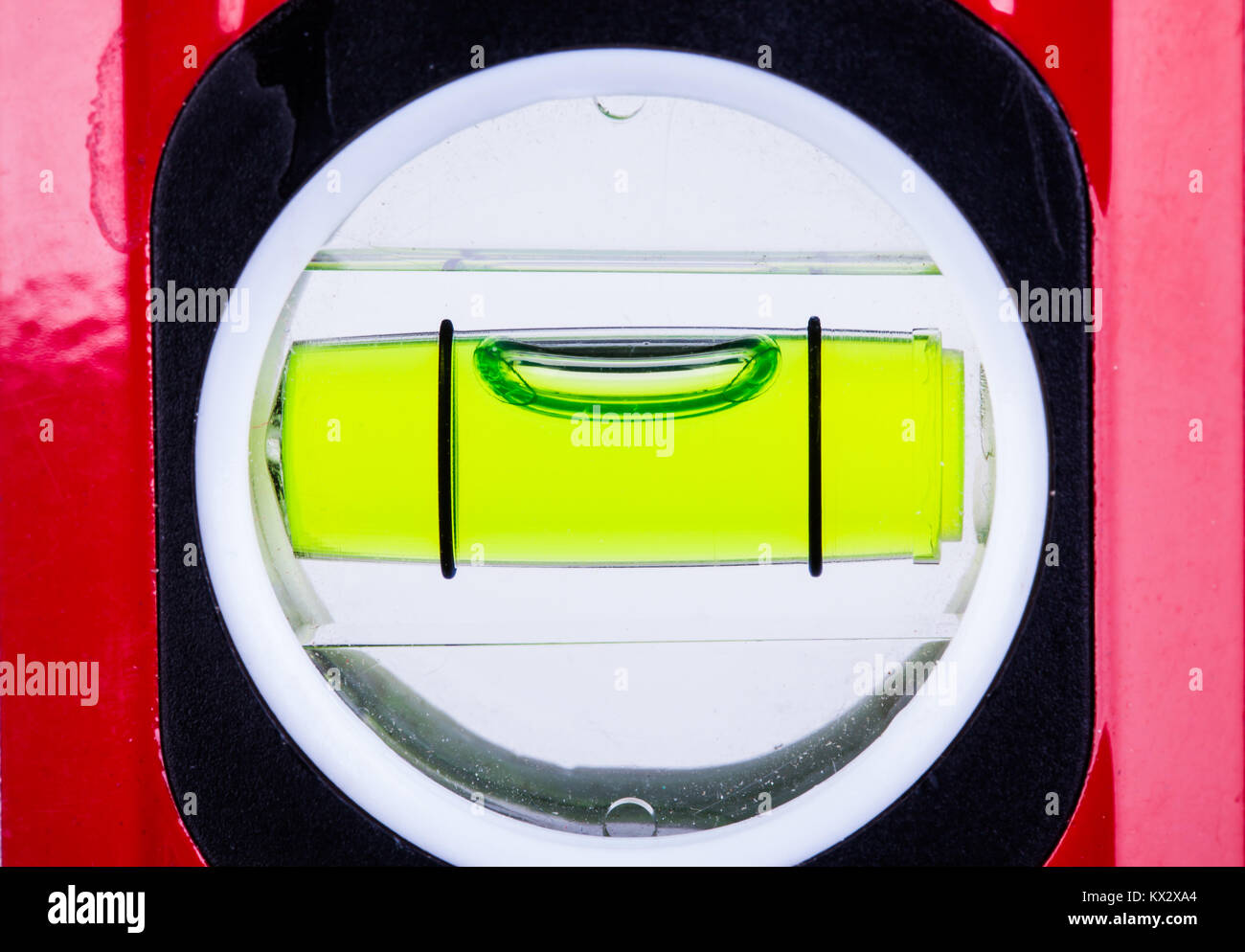 Spirit level bubble close up showing perfectly level alignment. Workman tool for finding the horizontal - Stock Image