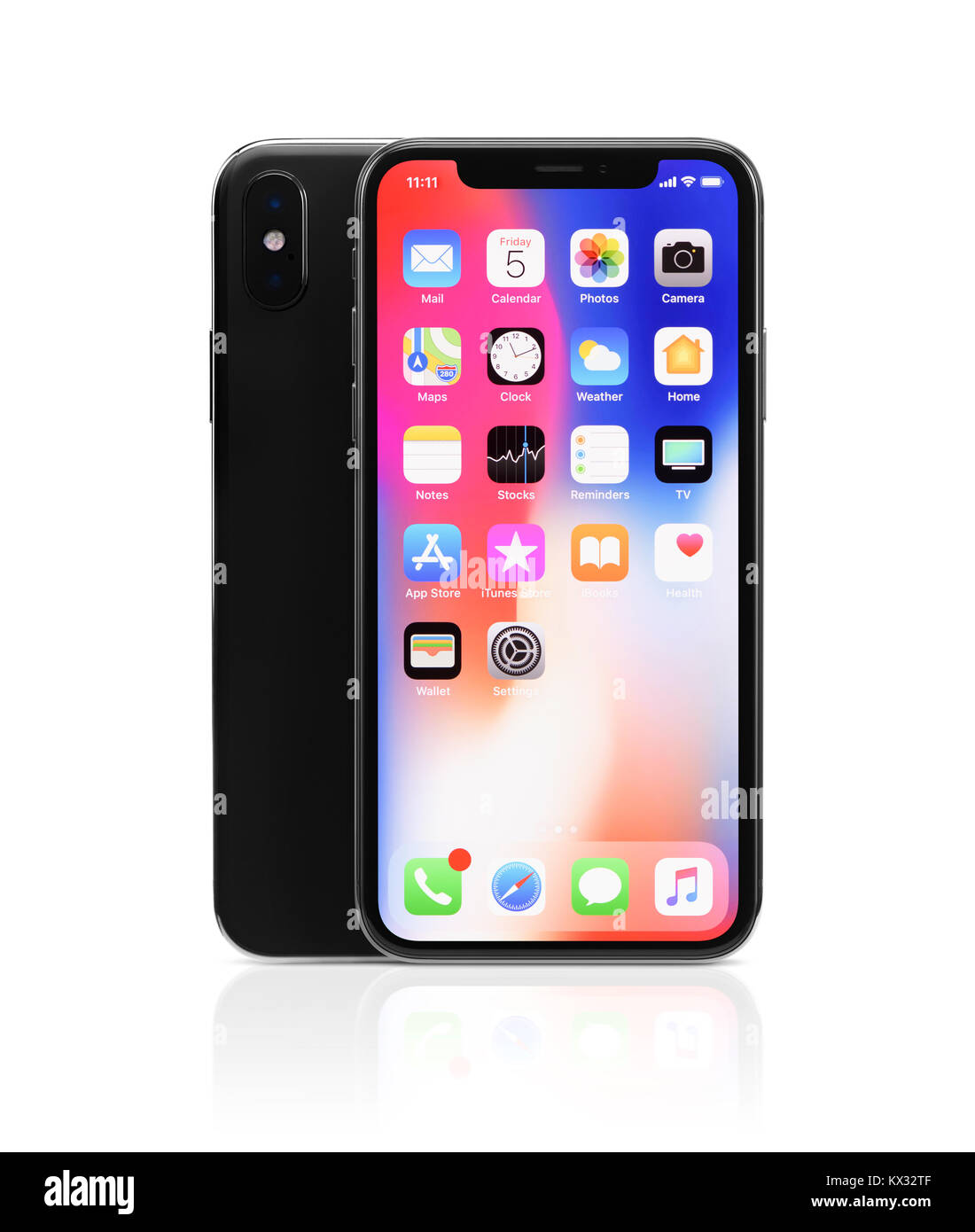 Apple iPhone X, large screen smartphone with dual rear camera, product still life with desktop and app icons on - Stock Image