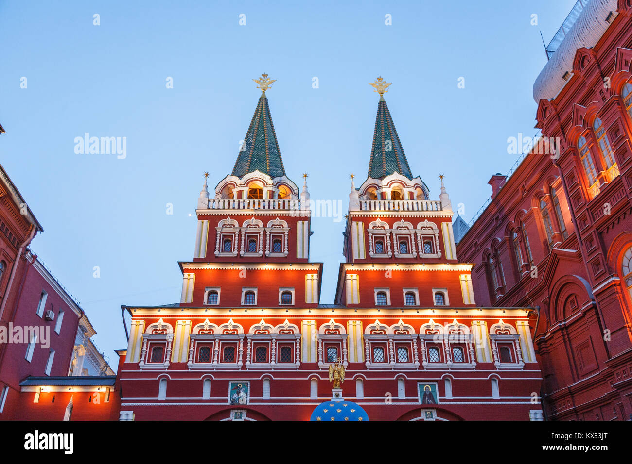 Iconic towers at the entrance gate to Red Square, Moscow, Russia, illuminated in the evening - Stock Image