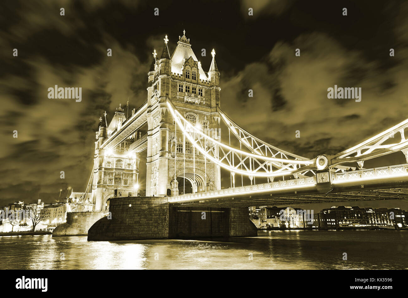 View of Tower Bridge in London at night. - Stock Image