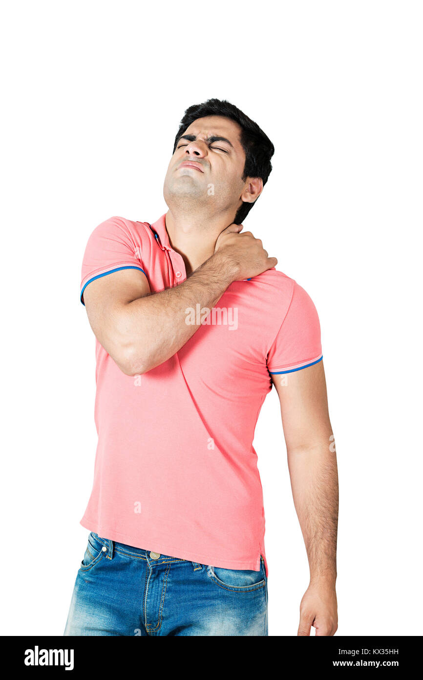 1 Indian man suffering from shoulder muscle inflammation or injury - Stock Image