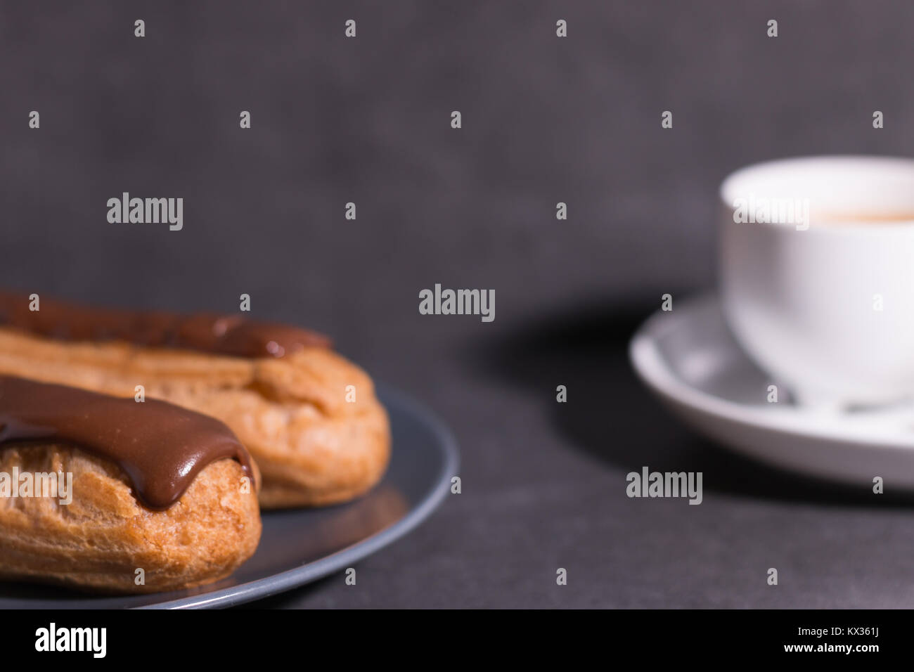 home backed eclairs with a cup of coffee - Stock Image