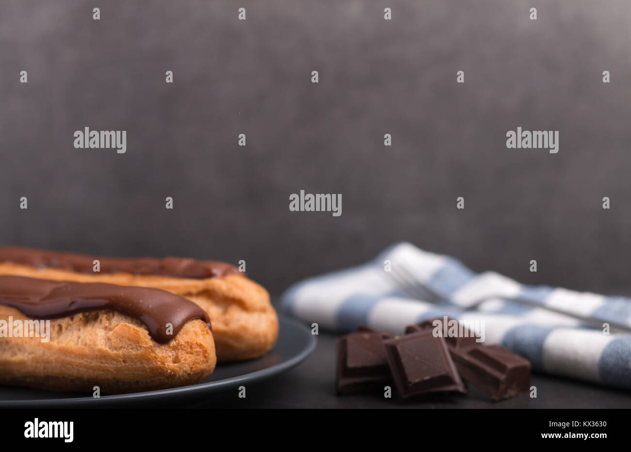 home backed eclairs with chocolate - Stock Image