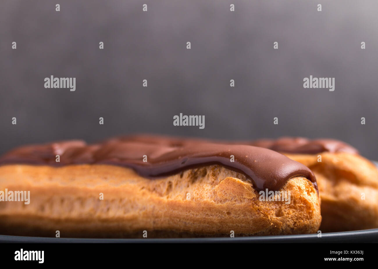 home backed eclairs close up - Stock Image