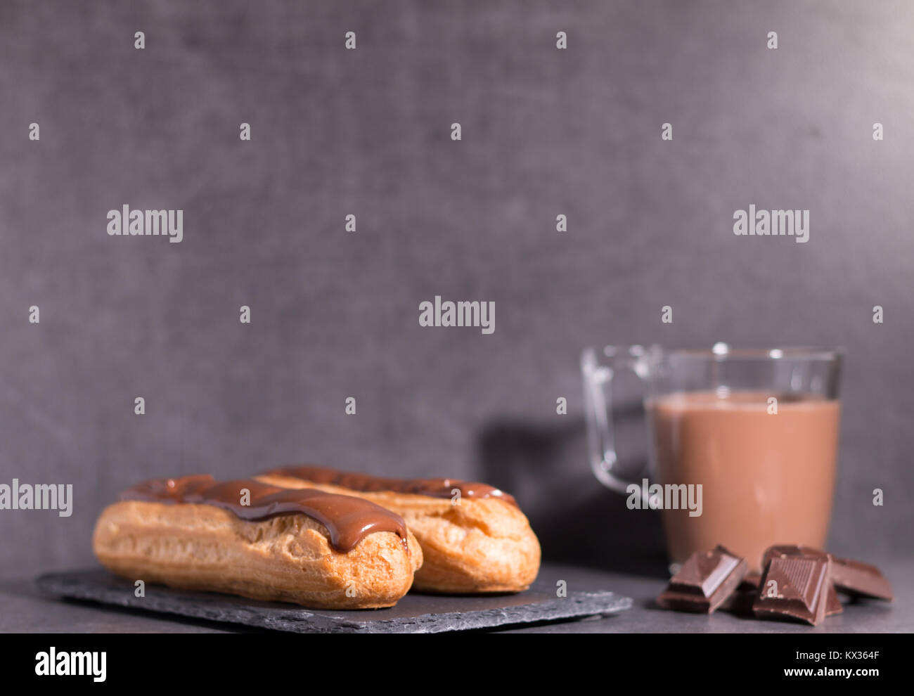 home backed eclairs with hot coco - Stock Image