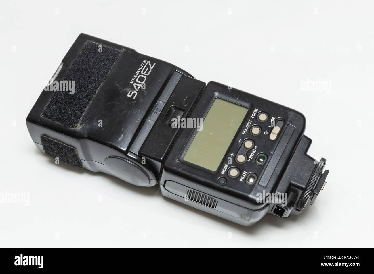 Canon speedlite flash gun, old, battered, scratched, tatty and heavily worn. Old photographic equipment. - Stock Image