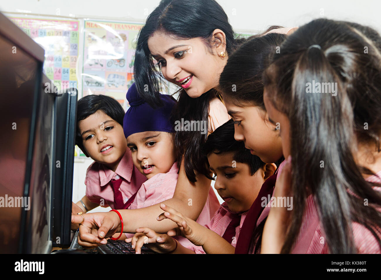 School Kids Students Teacher Teaching Computer Lab Education Learning Studying - Stock Image