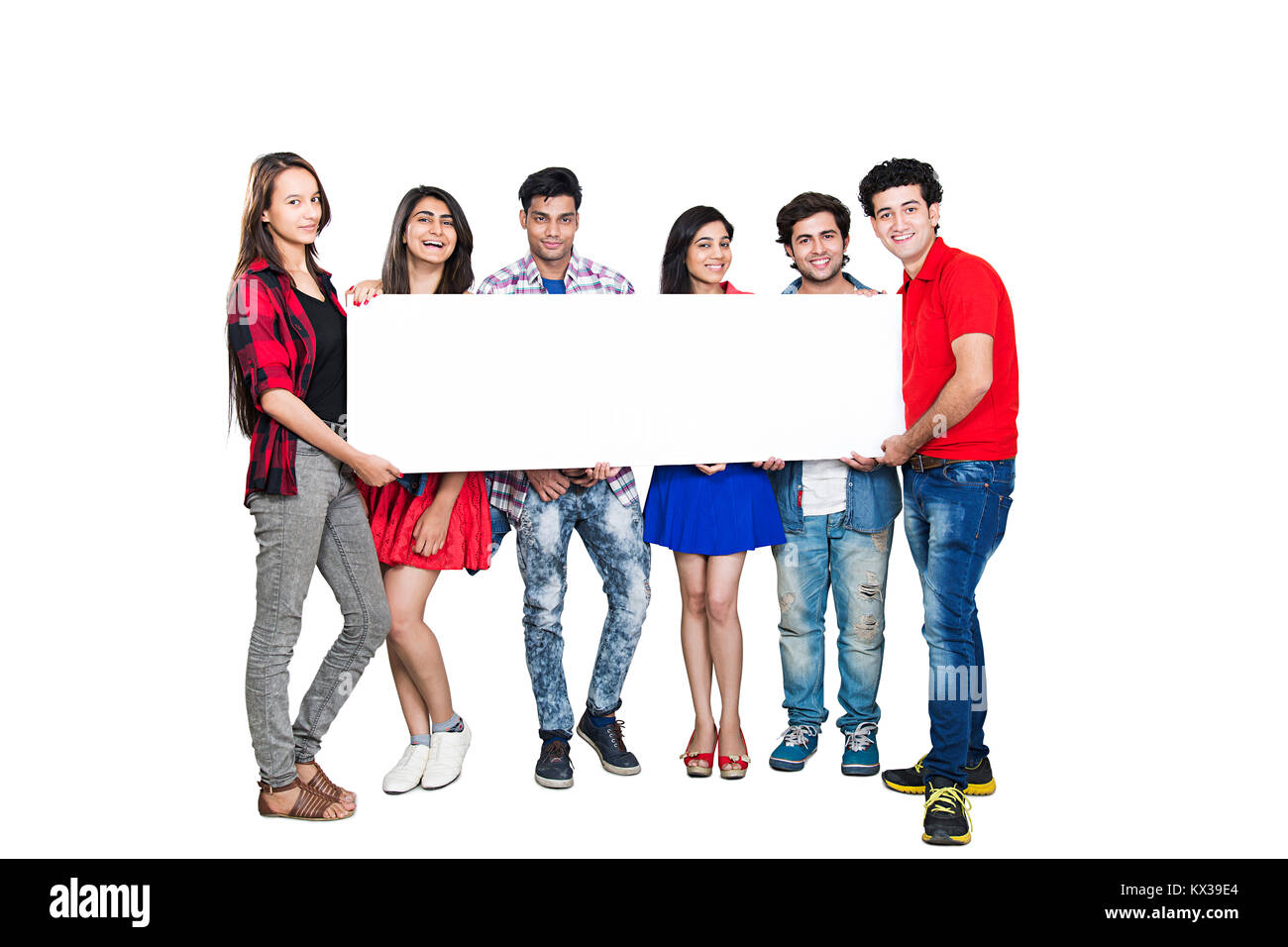 Indian Group College Student s Friends Standing Together Showing White Baord - Stock Image