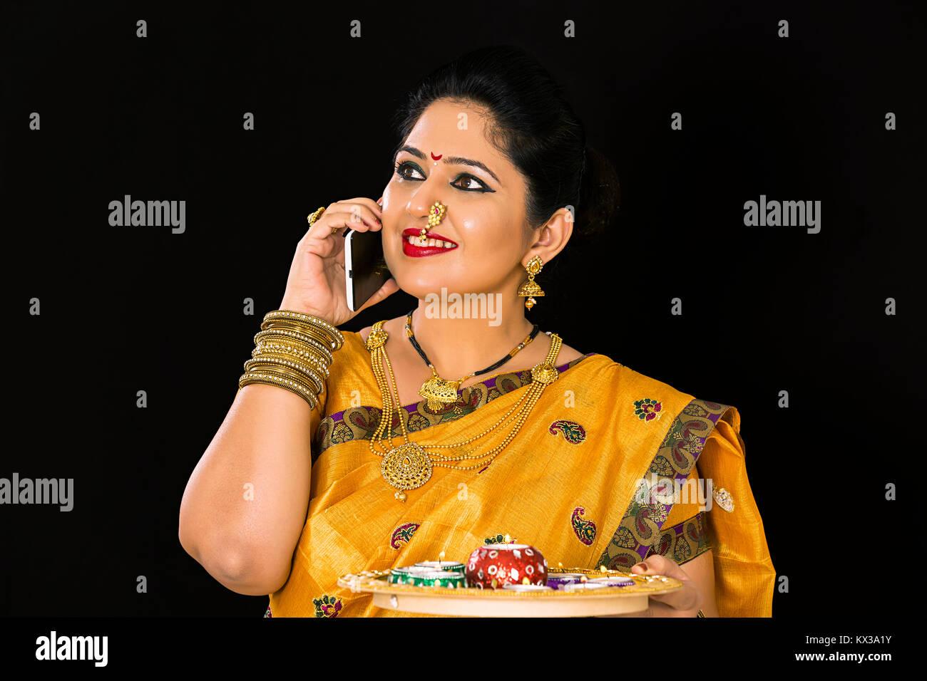Indian Marathi Woman Deepawali Festival Talking Phone Smiling - Stock Image