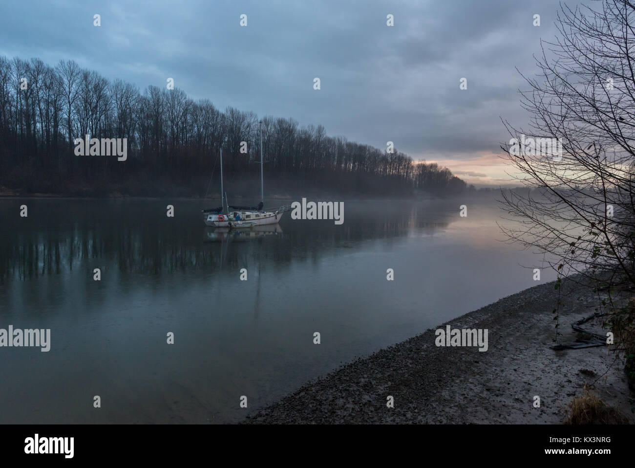 Sailboat anchored in the Bedford Channel of the Fraser River in Fort Langley, British Columbia, Canada. - Stock Image