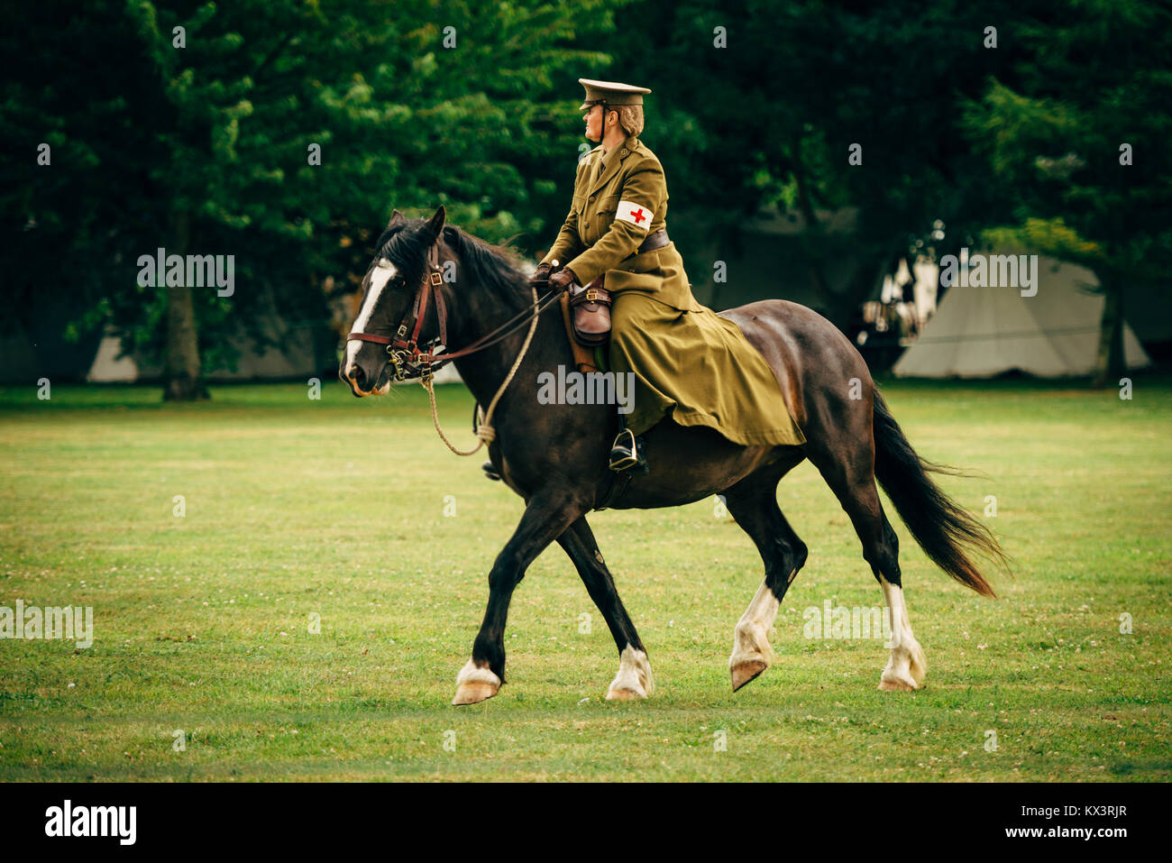 WWII combat medic riding a horse - Stock Image