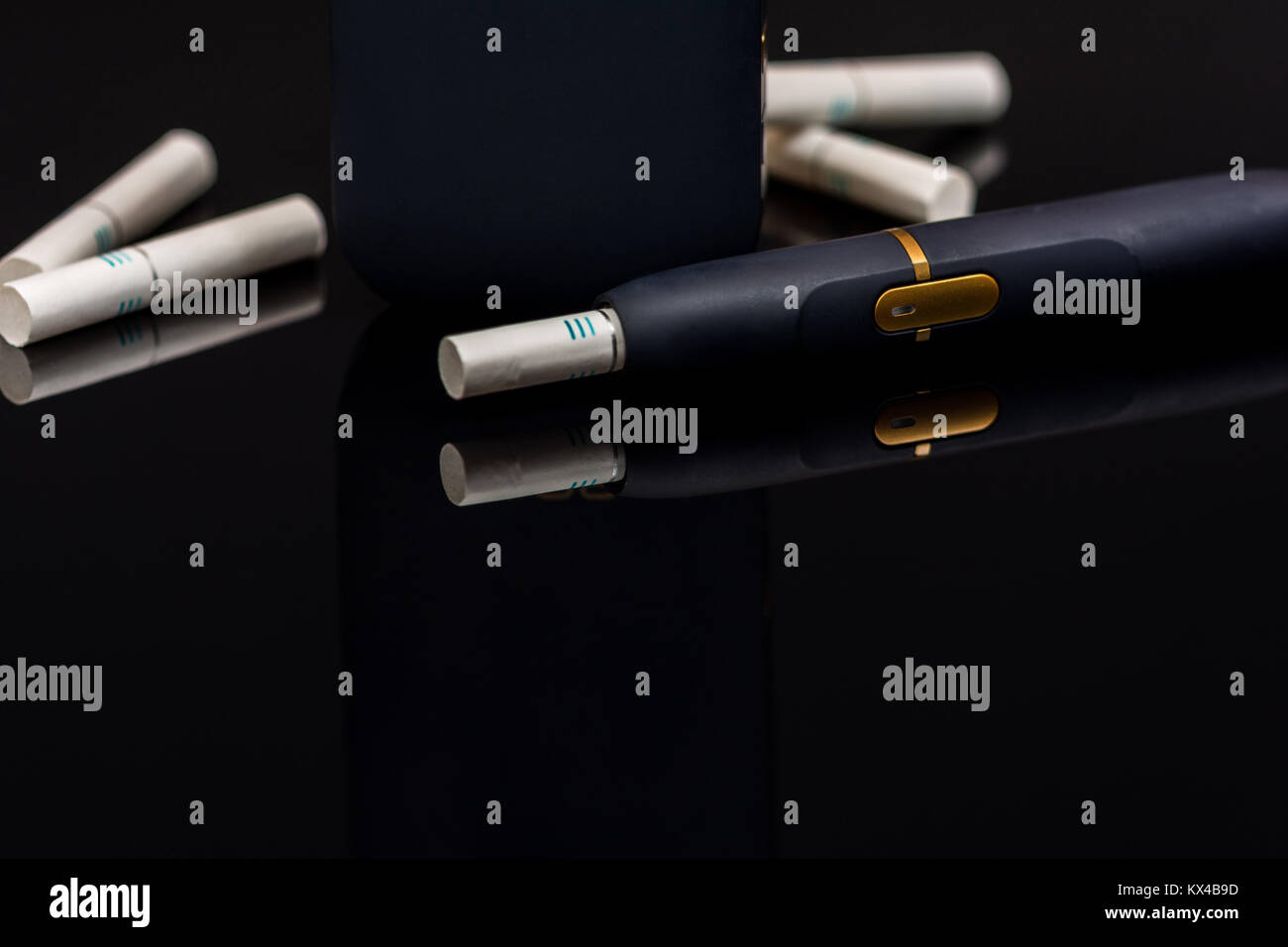 Electronic cigarette, tobacco heating system  on black background - Stock Image