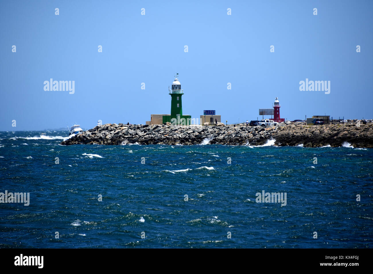 Starboard green and Port left lighthouse on a breakwater at the entrance to Freemantle harbour - Stock Image