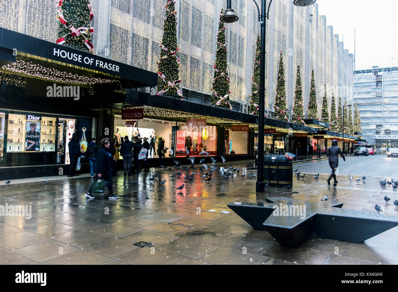 Oxford Street, London,House of Fraser department store,shop with Christmas decorations,xmas trees and January sale - Stock Image