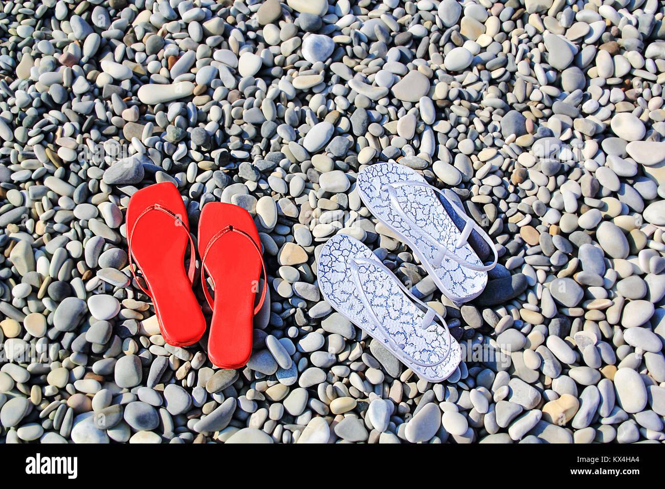 Image of varicoloured feminine schists on beach - Stock Image