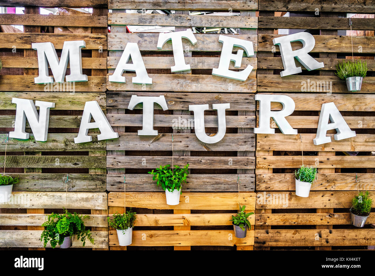 mater natura mother nature text green thumb pallets wooden background - Stock Image