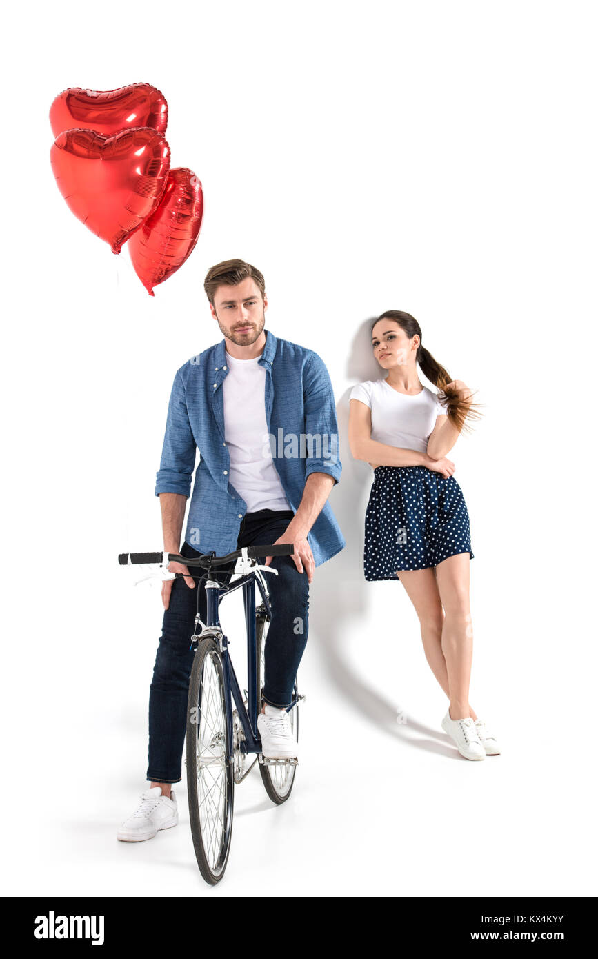 couple with bicycle and balloons - Stock Image