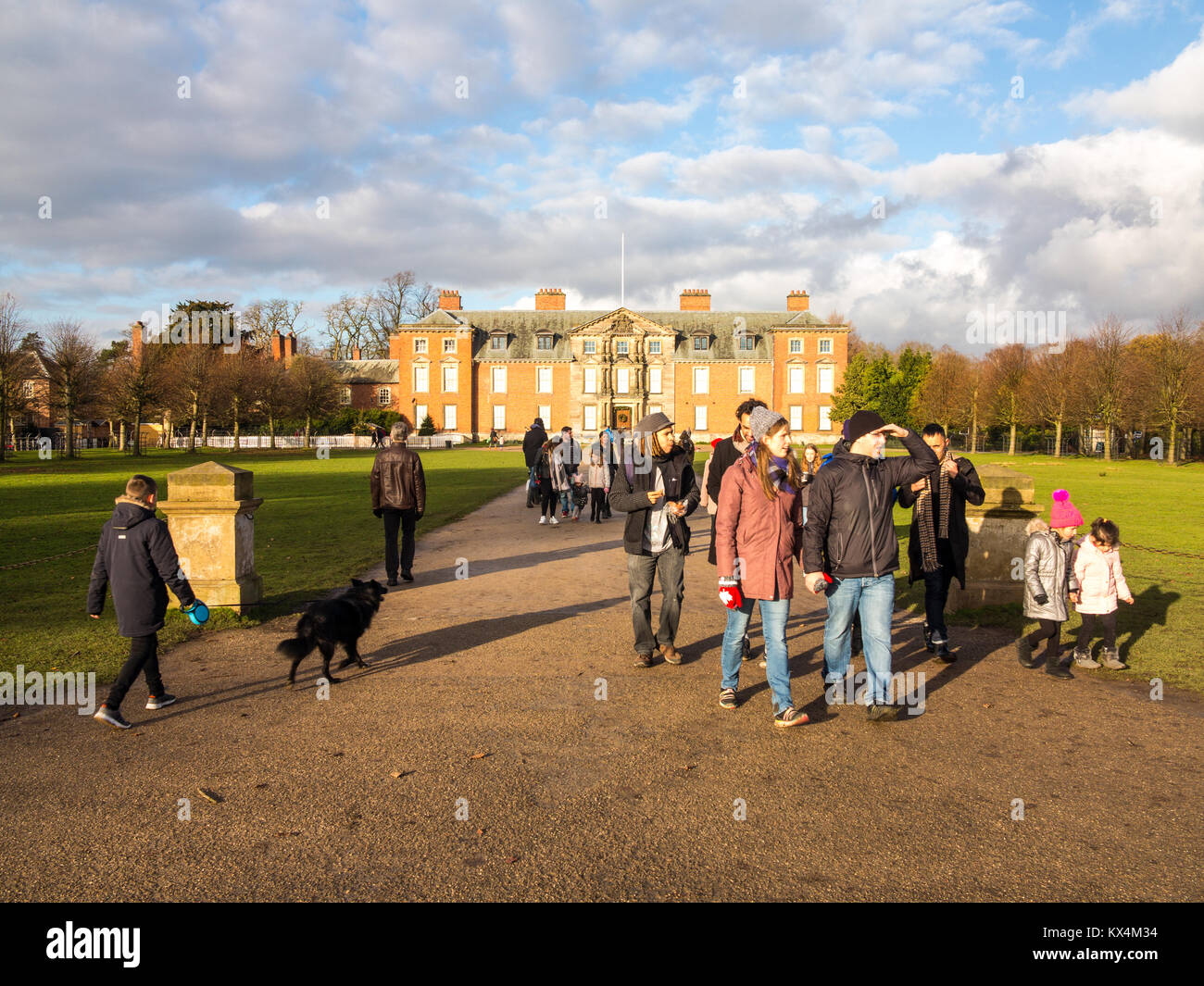Visitors outside the National Trust property of Dunham Hall at Dunham Massey  Cheshire England in the winter time - Stock Image