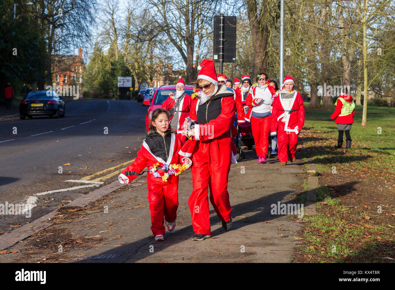 Northampton, U.K. Abington Park, 7th January 2018. A bright cold day for the rescheduled Santa Run which was supposed - Stock Image