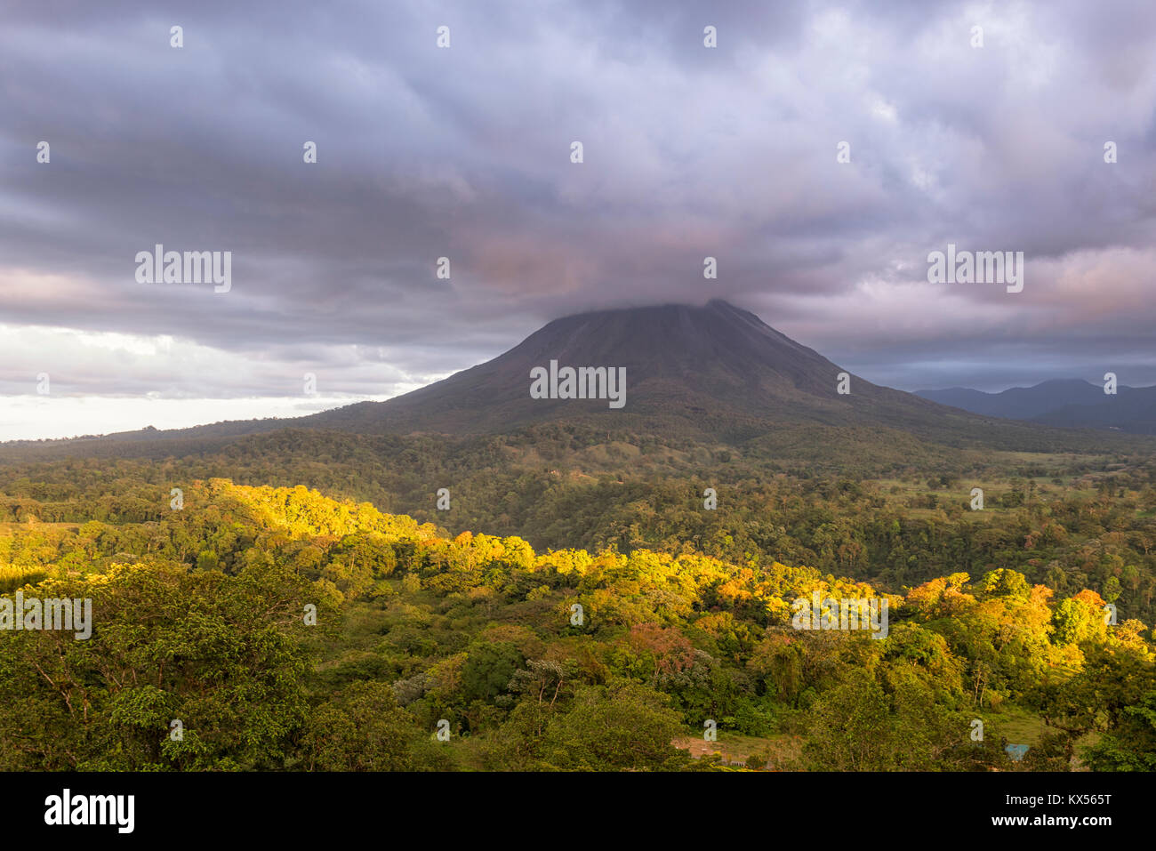 Volcano Arenal in clouds, Arenal Volcano National Park, Alajuela province, Costa Rica - Stock Image