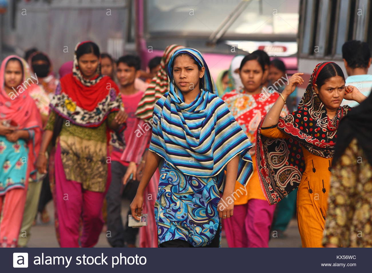 Garment worker returning to home after work, Dhaka, Bangladesh - Stock Image