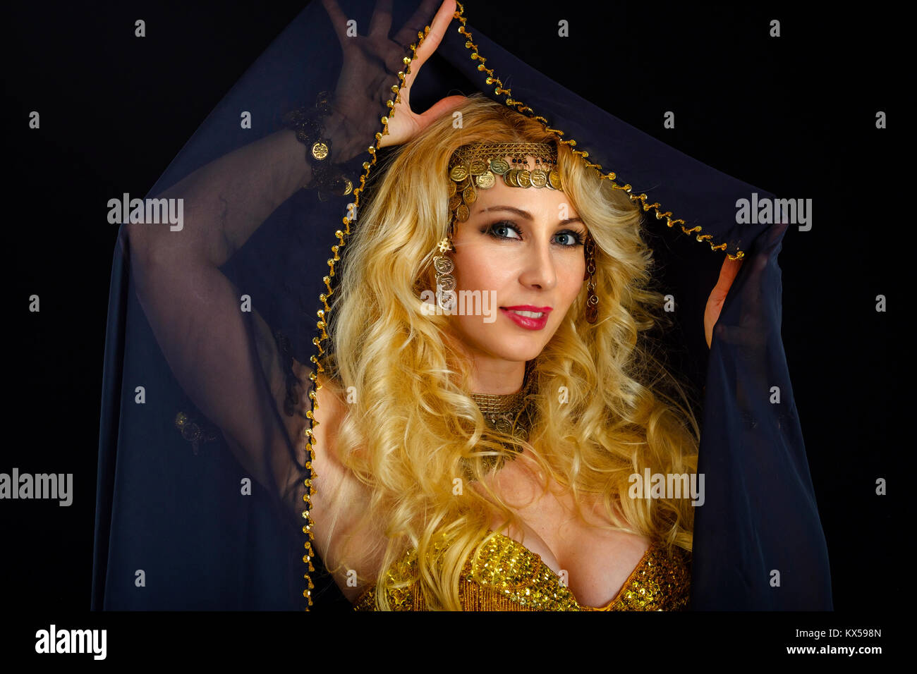 Woman fortune teller portrait at black - Stock Image