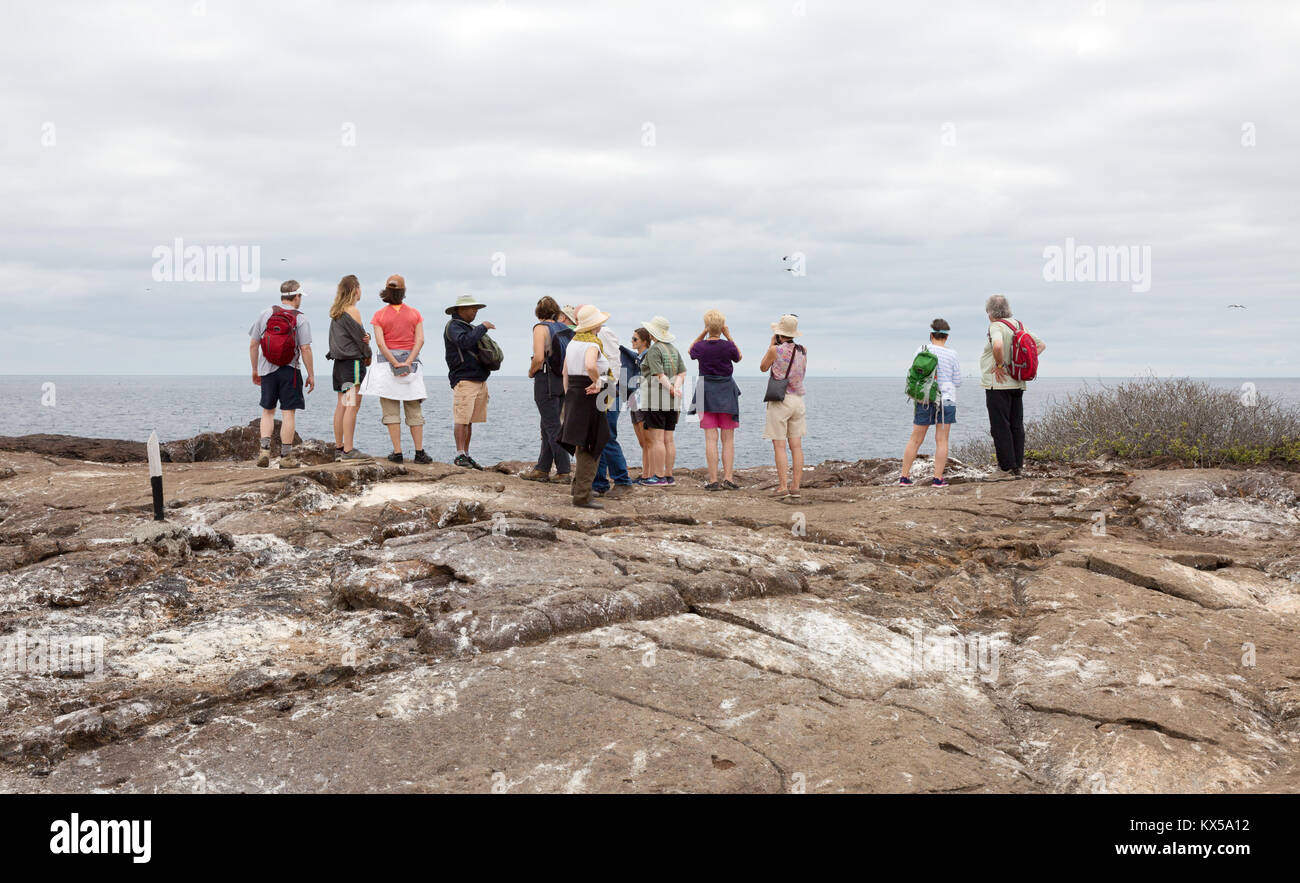 People walking on Genovesa Island as part of a guided tour, Galapagos Islands Ecuador South America - Stock Image