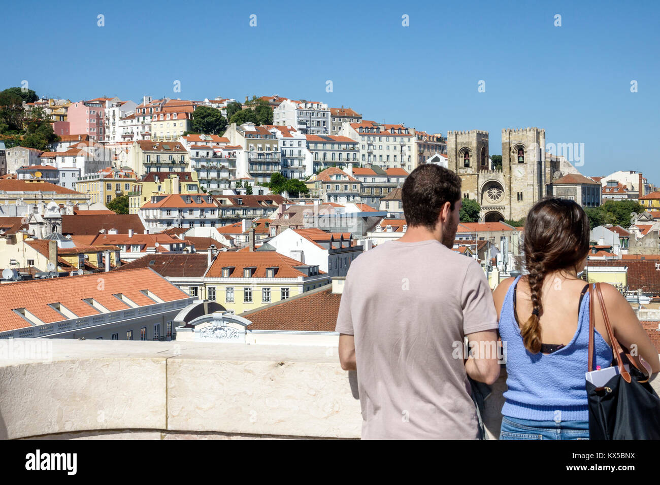 Lisbon Portugal Baixa Chiado historic center Arco da Rua Augusta arch viewing platform man woman couple city skyline - Stock Image